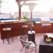 Custom_outdoor_BBQ_kitchen_with_granite_countertops_and_wood_cabinets.