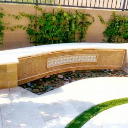Custom_water_feature_with_mosaic_tiles,_travertine_and_3_water_spouts